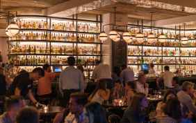 group of people gathering inside bar
